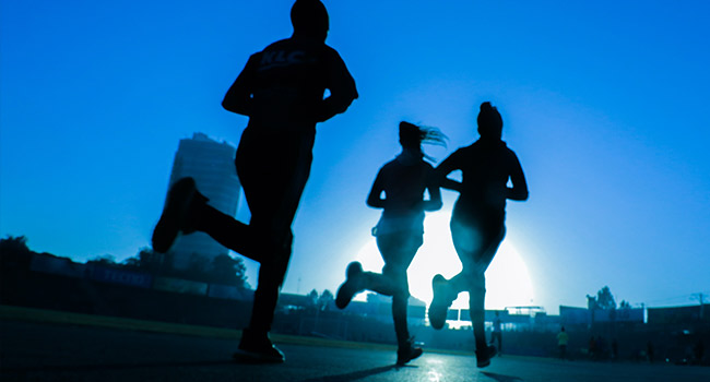 3 people jogging at dawn. Move for charity.