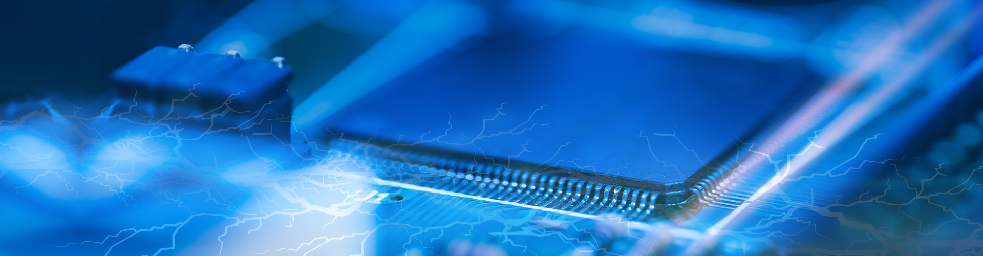 Lightning flashing over blue electronic components on circuit board.